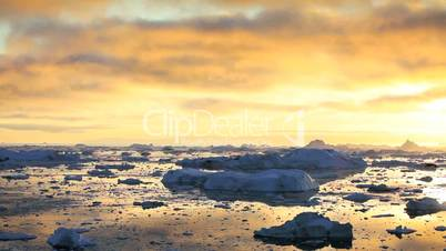 Melting Ice Floes at Sunset
