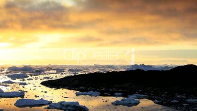 Pan Sunset of Melting Ice Floes