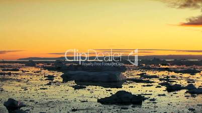 Pan of Golden Sunset over Melting Ice Floes