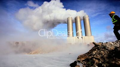 Female Engineer Inspecting Geothermal Power Station Chimneys