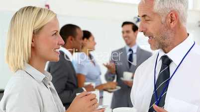 Business people chatting during coffee break: Royalty-free ...