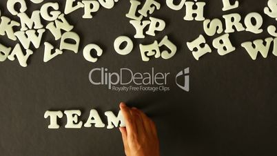 A person spelling Teamwork: Royalty-free video and stock ...  Teamwork Spellen