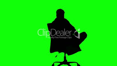 Silhouette%of%man%turning%of%swivel%chair%on%green%screen